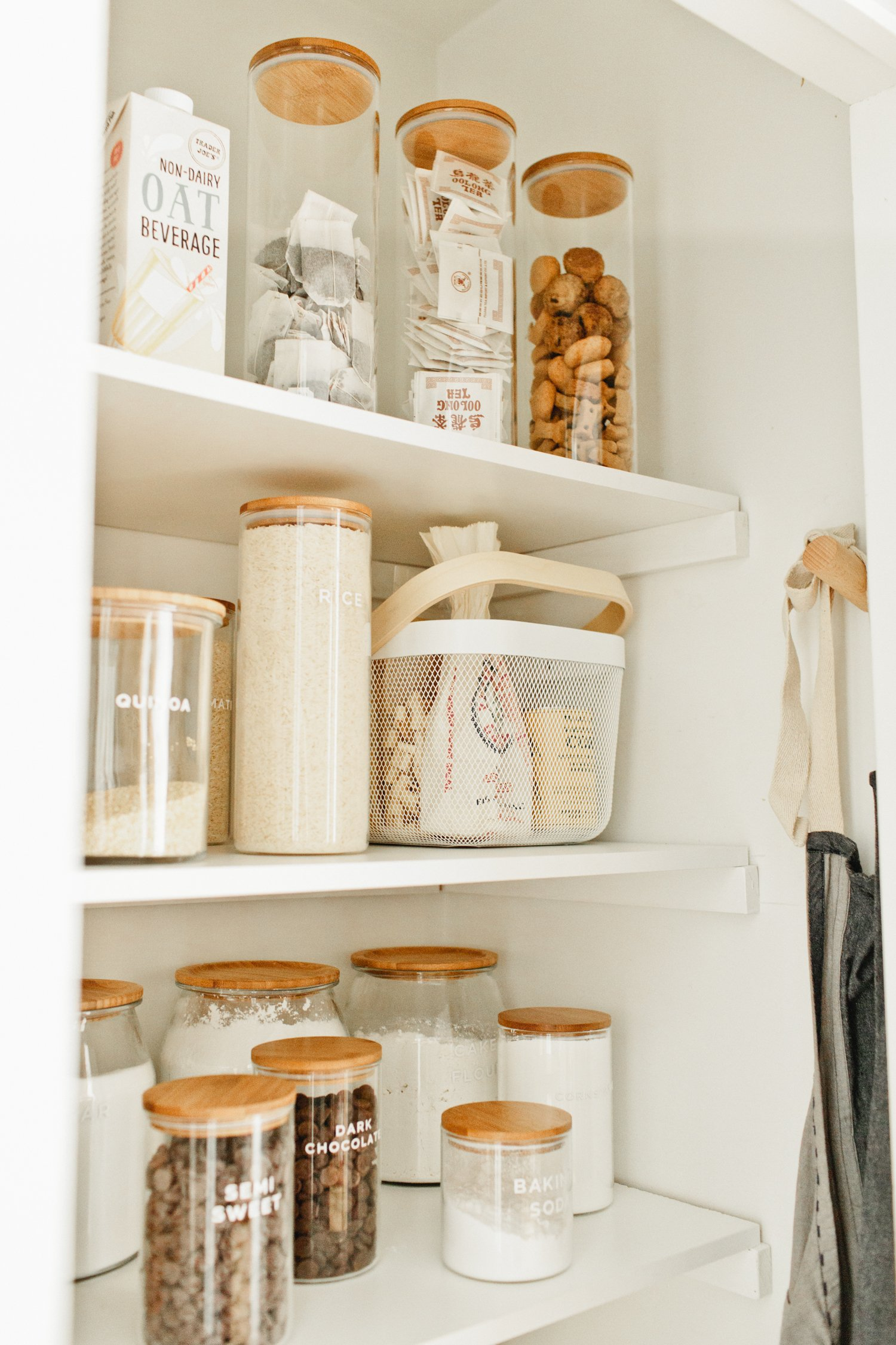 pantry organization with modern jars and baskest